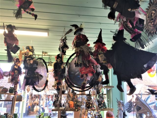 Witch puppets and dollshanging form th eceiling in the coven of Witches, Burley, New Forest