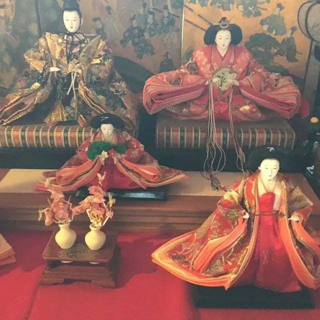 Traditional Hina dolls displayed on steps for the doll festival, Japan