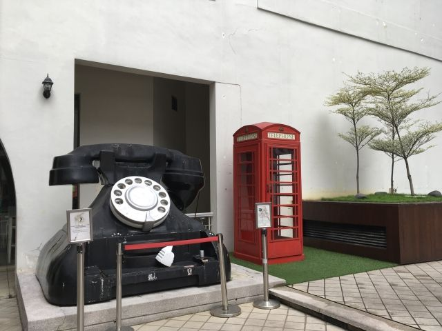Giant phone and red phone box at the Muzeum Telekom in Kuala Lumpur