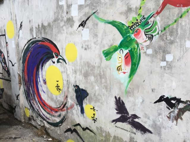 Mural of black and green birds in Klang, Malaysia