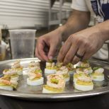 Guests at Jay Ducote's James Beard Preview Dinner enjoy Jay D's Molasses-Mustard deviled eggs Friday, July 8, 2016 at the Louisiana Culinary Institute.