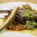 Guests at Jay Ducote's James Beard Preview Dinner enjoy venison tenderloin with chimichurri and okra three ways Friday, July 8, 2016 at the Louisiana Culinary Institute.