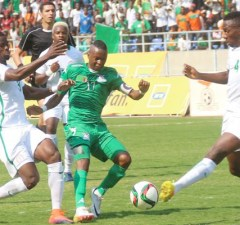 Zambia Chipolopolo skipper Rainford Kalaba tries to beat his opponent
