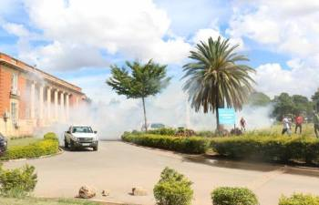 Police teargas UPND supporters at High Court after clashing - picture by UPND media team