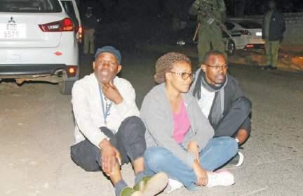 Post editor-in-chief Fred M'membe, his wife Mutinta and Joseph Mwenda in Lusaka
