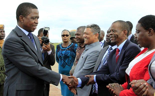 President Edgar Lungu greets Francis Katema at KKIA in Lusaka-Picture by Tenson Mkhala