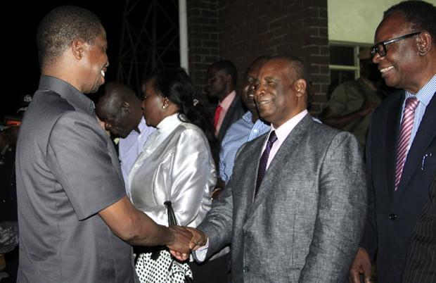 President Edgar Lungu greets former Education minister Michael Kaingu at KKIA-Picture by Tenson Mkhala