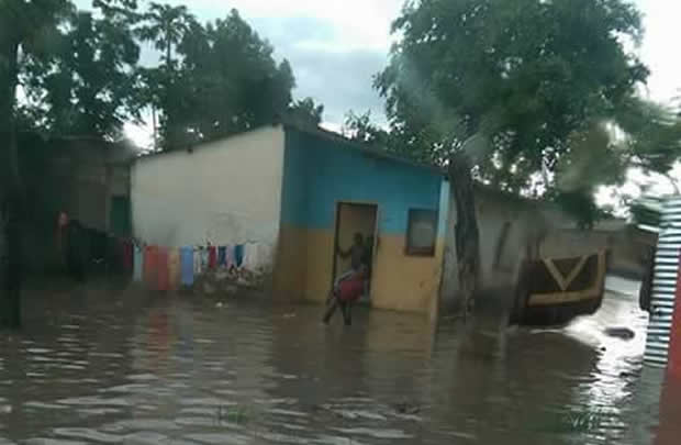 House in Lusaka's Misisi Compound almost submerged in water leaving occupants stranded.