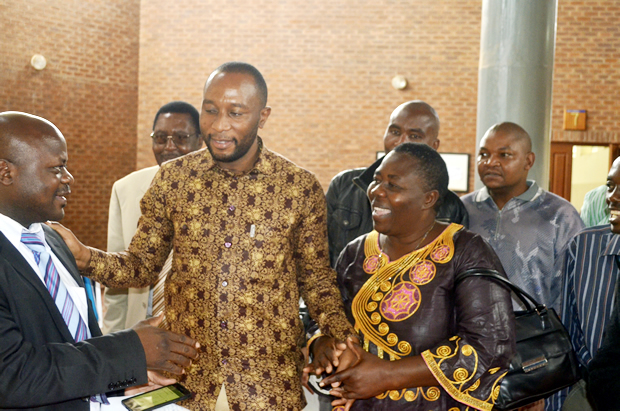 Mark Mubalama (r) with his auntie Mervis Musanga and other relatives at Lusaka's Magistrates Court -February 27, 2017-Picture by Tenson Mkhala
