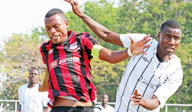Zanaco skipper Ziyo Tembo(l) battles with an opponent: File picture