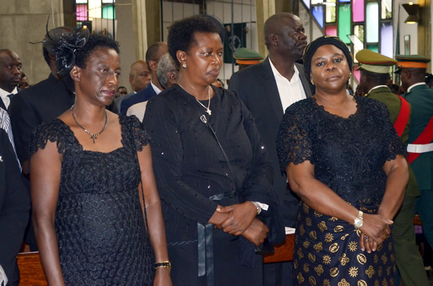 Former first lady Maureen Mwanawasa (r) among mourners during a church service for Regina at Cathedral of the Holy Cross in Lusaka-picture by Tenson Mkhala
