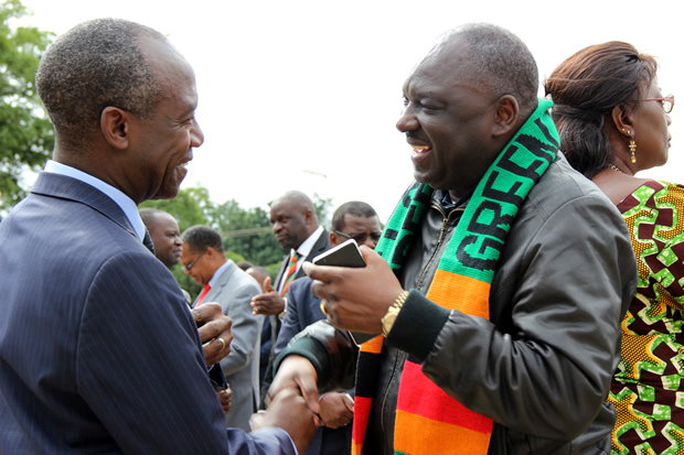 Defense minister Davis Chama speaks to DMMU national coordinator Patrick Kangwa during Youth Day celebrations in Lusaka-Picture by Tenson Mkhala