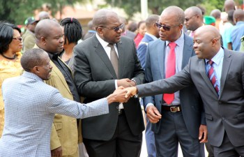 Home Affairs minister Stephen Kampyongo greets deputy minister in the office of the vice president Lawrence Sichalwe as Health minister Dr Chitalu Chilufya and Housing and infrastructure minister Ronald Chitotela during Youth Day celebrations in Lusaka-picture by Tenson Mkhala