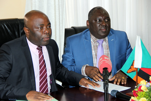 Defense minister Davis Chama with Home Affairs counterpart Stephen Kampyongo during a joint press briefing in Lusaka -picture by Tenson Mkhala