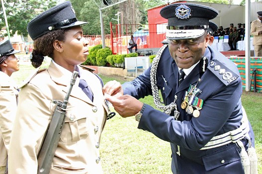 Inspector General of Police Kakoma Kanganja jokes with photojournalists while awarding officers at the 2017 Police Day at the Lusaka showgrounds on March 4 - Picture by Joseph Mwenda