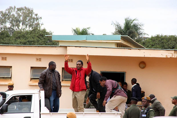 UPND leader Hakainde Hichiilema waves at supporters as he was taken back to Lusaka Central Prison-picture by Tenson Mkhala