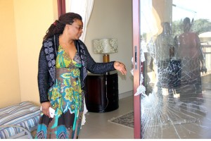 Mutinta Hichilema showing this reporter a widow that was broken by police during a raid-Picture by Tenson Mkhala