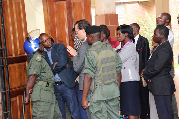 Police blocks USA deputy chief of section for political and economic affairs Matthews Petit from getting inside the court-picture by Tenson Mkhala