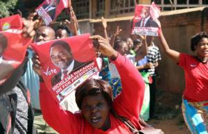 UPND supporters display HH's placard at Court-Picture By Tenson Mkhala