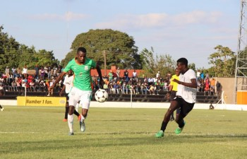 John Chigandu of Zesco United with a ball as he tries to beat his opponent of City of Lusaka at Woodlands Stadium. Zesco won 1-0 Picture By Tenson Mkhala