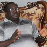 Former Information Minister Chishimba Kambwili speaks to journalists at his house in Lusaka - Picture By Tenson Mkhala