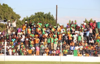 Zesco fans celebrate shortly after their team scored in a game against City of Lusaka at Woodlands Stadium. Zesco won 1-0 Picture by Tenson Mkhala