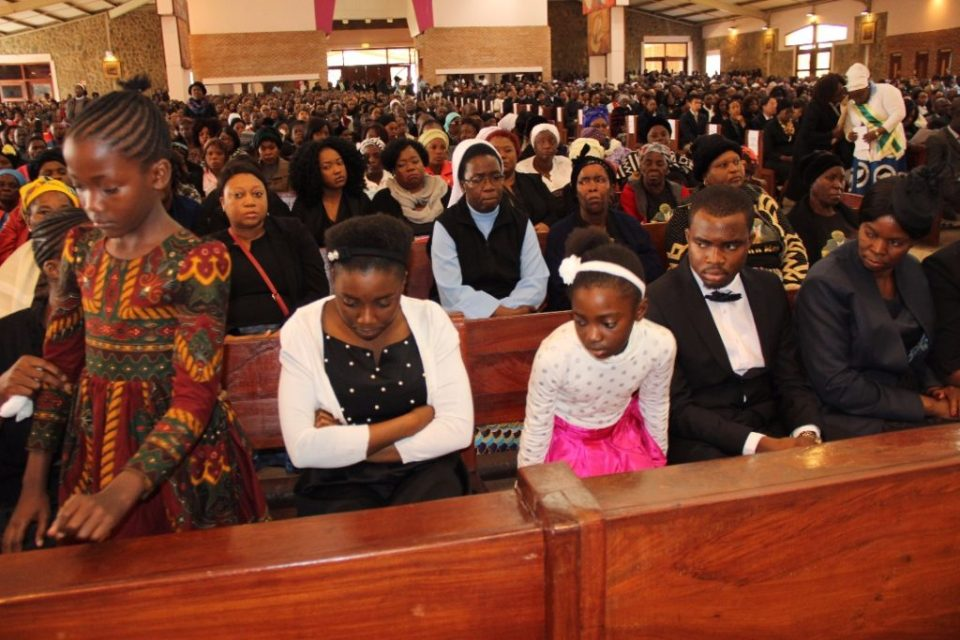 Mourners during church service of late Health permanent secretary John Moyo at the Cathedral of the Child Jesus Catholic church in
