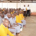 A Kenyan government official addresses inmates in Nairobi Prison. Kenya allowed prisoners to vote in the recently ended polls