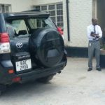 NDC secretary general Mwenya Musenge looks at his smashed vehicle at 5fm today