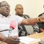 NDC consultant Chishimba Kambwili addresses journalists as Ackson Kaonga and Saboi Imboela (r) listen at the party secretariat in Lusaka on June 11, 2018 - Picture by Tenson Mkhala