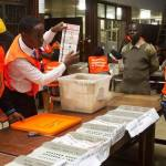 An ECZ officer announces election results to party observers