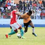 Zambia's Martin Njobvu vies for the ball with Burundi's Nahimirimana Jospin
