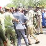 Police officers barracked as they block UPND leader Hakainde Hichilema and his vice Geoffrey Mwamba not to pass between the military parade at the Anglican Cathedral of the Holy Cross in Lusaka shortly after attending the requiem mass for late freedom fighter Mama Chibase Kunda on November 3, 2018 – Picture by Tenson Mkhala