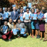 British High Commissioner to Zambia Fergus Cochrane-Dyet poses for a photo with Chevening scholars during their pre departure program at the British High Commission in Lusaka on August 20, 2019 - Picture by Tenson Mkhala