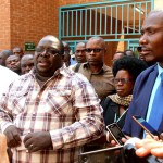 NDC leader Chishimba Kambwili being franked by Roan MP Joseph Chishala (r) and party secretary general Bridget Atanga speaks to journalists at Lusaka Magistrate's Court on September 30, 2019