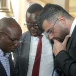 L-r: Former special assistant to the President for press and public relations Amos Chanda, lawyer Jonas Zimba and Intelligent Mobility Solutions board chairman Walid El Nahas  when they appeared at the Lusaka Magistrates' Court on January 28, 2020 – Picture by Tenson Mkhala