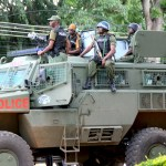 Armed Police officers keep vigil during the UNZA Students' protest against against gassing and Tribalism on February 19, 2020 – Picture by Tenson Mkhala