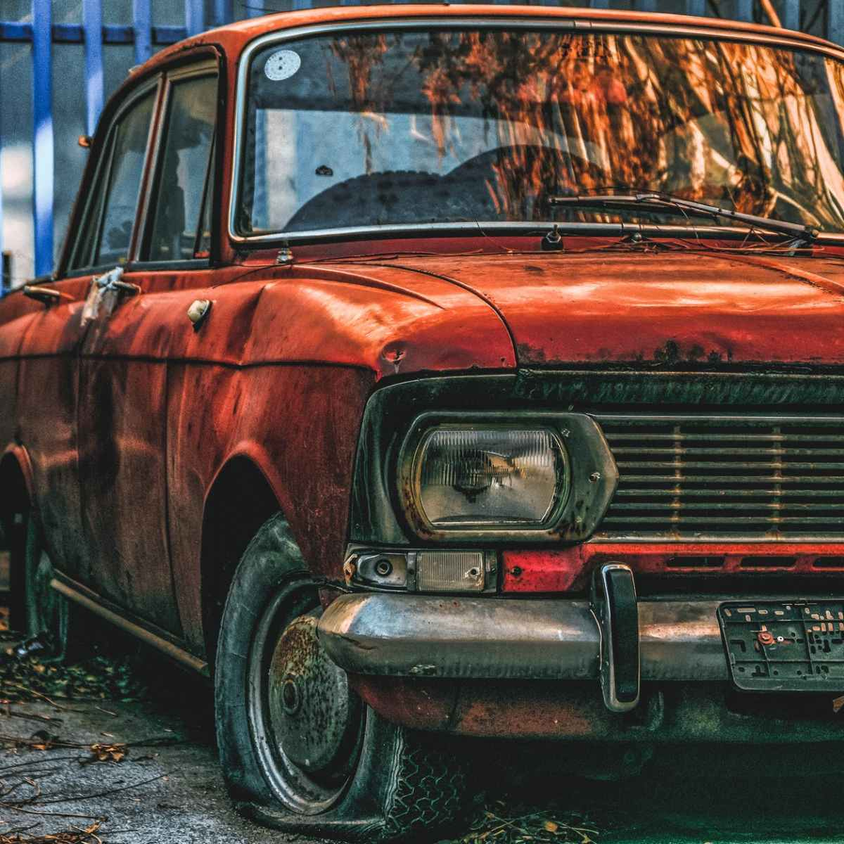 illustration of orange sedan
