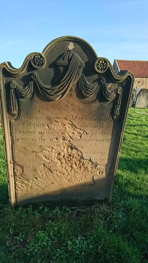 Draped urns on gravestones in St Mary's Church, Whitby, North Yorkshire