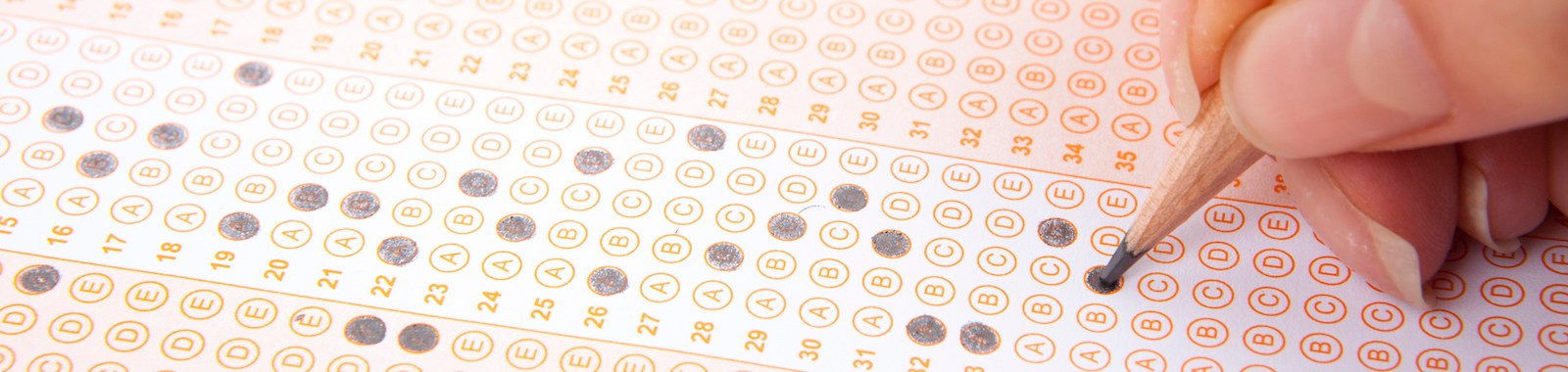 Hand on pencil choosing the test list on the examination.