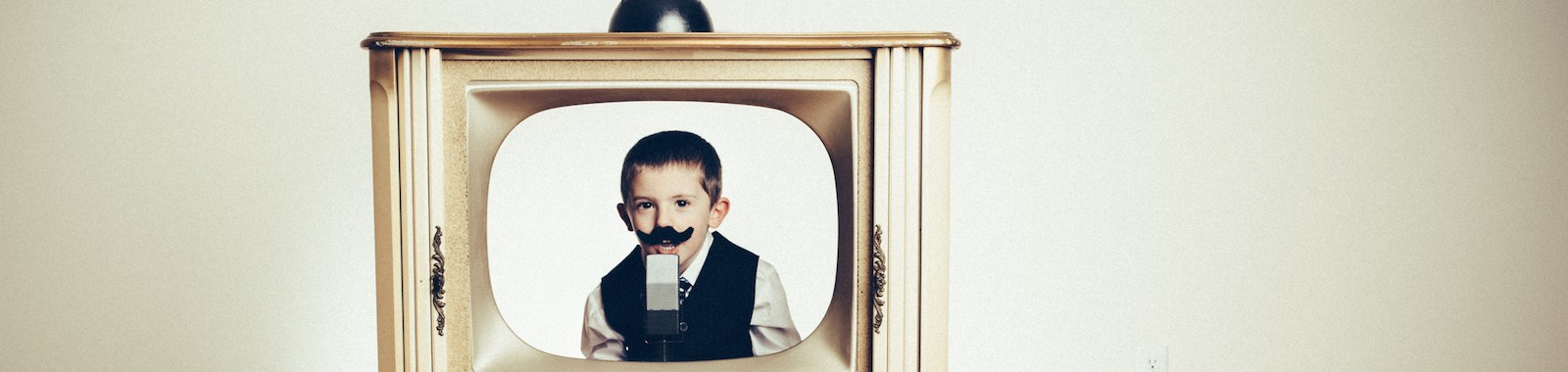 Preschool Child Playing Anchorman in Old TV