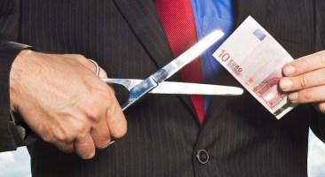 Businessman slicing Euro bill