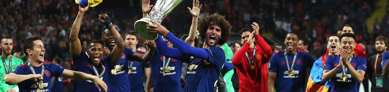 STOCKHOLM, SWEDEN - MAY 24:  Marouane Fellaini of Manchester United celebrates with The Europa League trophy after the UEFA Europa League Final between Ajax and Manchester United at Friends Arena on May 24, 2017 in Stockholm, Sweden.  (Photo by Julian Finney/Getty Images)