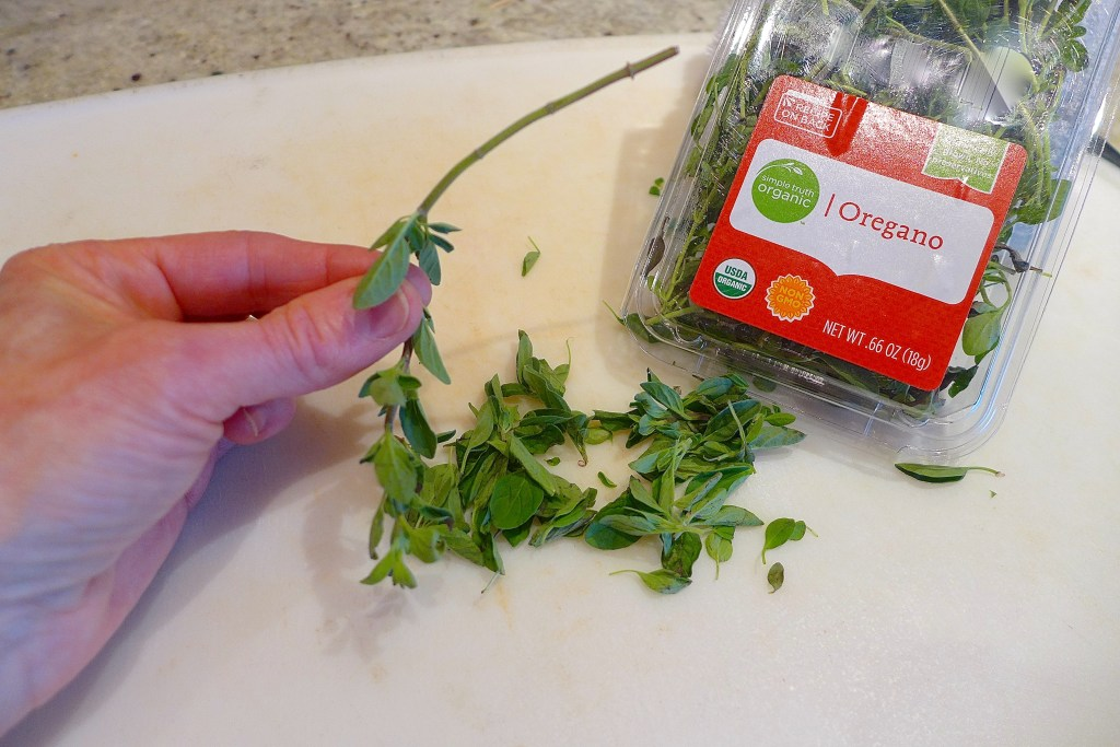 Remove herbs by holding stems upside down and pulling herbs upward and off.