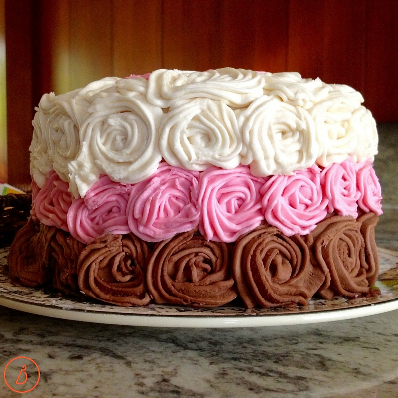 White, strawberry and chocolate rose birthday cake.