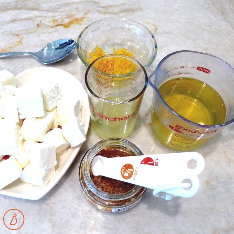 Get set up to blend feta, lemon, garlic and oil in a food processor. Recipe for Easy Creamy Lemon and Feta Dip at diginwithdana.com