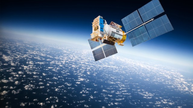 A satellite in space highlighting the UK's growing space sector.