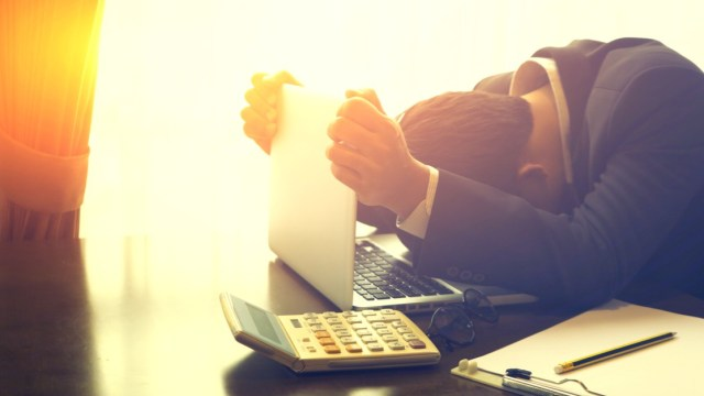 depressed businessman at laptop