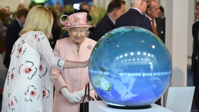 Queen Elizabeth II being shown Pufferfish's sphere