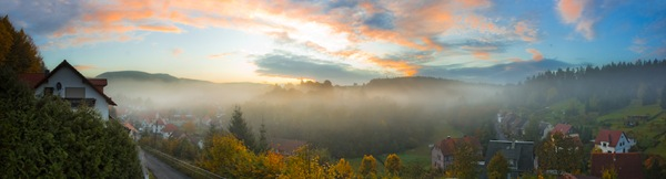Mist covering village - Panorama